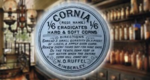 N.O. Ruffel Corn Salve - This is the only blue lid recorded from a South African Company - N.O. Ruffel was a thriving chemist at the turn of the century and a wide range of bottles / flasks bear his name - Diameter 65 mm - This lid has a matching blue base.