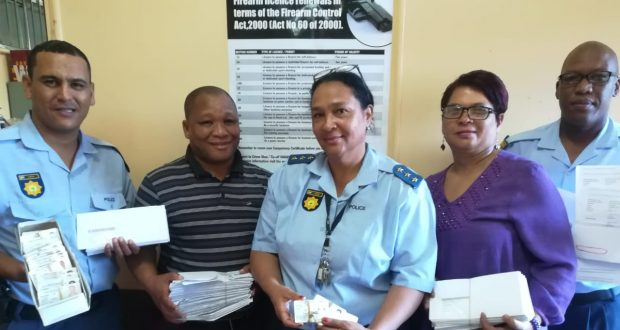 Sgt Moegamat Hassan, AK Jan Van Wyk, Capt Erica De Vos, AK Daisy Frits and Const Teboho September with firearms licence cards and competency certificates not picked up yet.